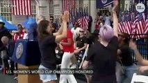 The U.S. women's soccer team celebrates fourth...
