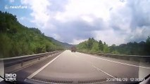 Planks flying off truck smash trailing car's windscreen in China