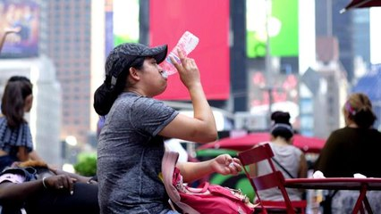 What are the warning signs of heat-related illness?