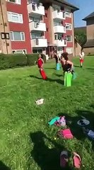 Woman faceplants during sack race