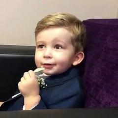 Young boy raising his eyebrows