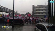 Protesters continue to march amid heavy rain