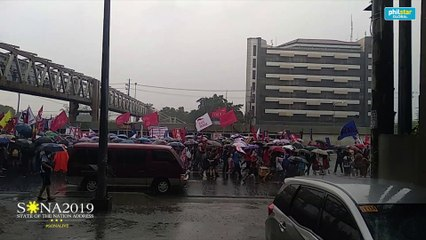 Protesters continue to march amid heavy rain