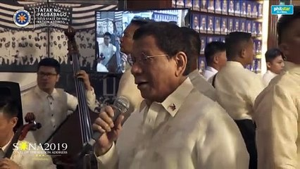 Duterte sings with Philippine Philharmonic Orchestra