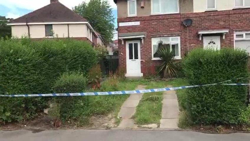 Flowers left in Sheffield street after murder
