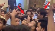 Sara Ali Khan mobbed by fans; Kartik Aaryan protect her; Check Out   FilmiBeat