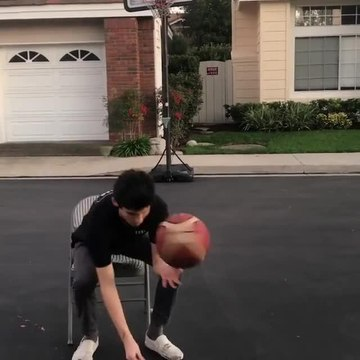 Guy Spins Basketball on Spoon Handle While Eating From It