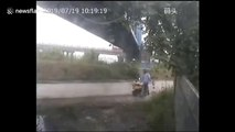 Truck trailer narrowly misses man after smashing into bridge in China