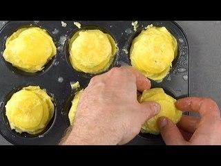 Türme Kartoffeln im Muffin-Blech. 5x roher Schinken und 4x Käse machen dann den Rest.