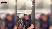 Une femme hystérique frappe violemment son mari dans un avion (Vidéo)