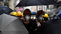 Violence escalates in Hong Kong as police fire tear gas on demonstrators