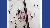 Des balançoires entre le mur USA / Mexique
