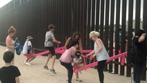 Watch: Mexican and American children play across border wall on pink seesaws