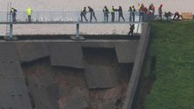 British military helping shore up damaged dam as risk of flooding of UK town rises