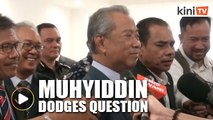 Muhyiddin walks away from question on opposition's backing for Dr M