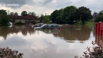 Cars float in water at Grangemouth Premier Inn car park in Scotland amid heavy flooding after severe thunderstorm