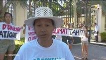 Citoyens pour le climat manifeste devant les grilles de la Présidence