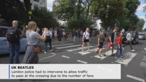 Beatles fans gather at Abbey Road 50 years after famous album