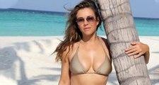 Güzel model Elizabeth Hurley, havuzda üstsüz poz verdi
