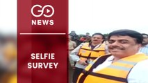 Maharashtra Minister Takes Selfie During Flood Survey