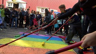 Residents paint street in colours of rainbow flag to celebrate Reykjavik Pride