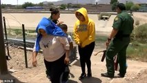 Video shows US border patrol agents helping people scale walls and giving pats on the head   Daily M