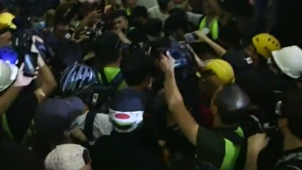 Violence erupts at Hong Kong airport as protesters clash with police