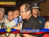 Aquino visits 'Basyang' victims, distributes relief goods
