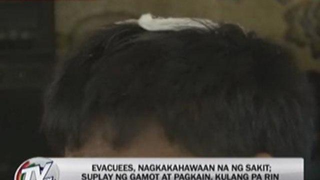 Diseases spreading in evacuation centers