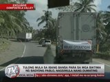 EXCL: 'Pablo' survivors run after truck of relief goods