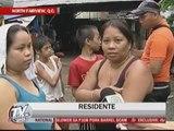 Heavy rains trigger floods in Quezon City