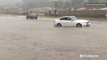 Dangerous driving conditions arise as streets fill with water