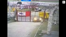 He leaves the car to open the gate and gets robbed within a second