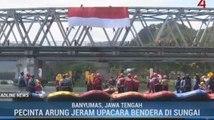 Ratusan Pecinta Arung Jeram Upacara Bendera di Tengah Sungai