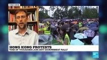 Hong Kong protesters stay peaceful as China keeps close