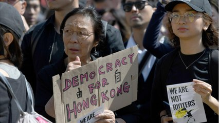 Hong Kong: Peaceful Protesters Throng Streets In Rain