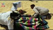 إقبال على حمامات رمال جبل الدكرور فى واحة سيوة لعلاج العظام