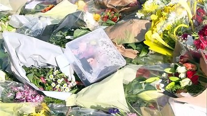 Police officers visit PC Harper's murder scene