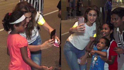 Sara Ali Khan clicks selfie with her little fans at airport;Watch video | FilmiBeat