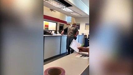 Elderly white man yells racist words at black post office worker