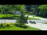 Kid Uses Hoverboard to Push Grass Trimmer and Clean Garden