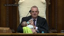 Amazing! Politician feeds and cradles baby during debate
