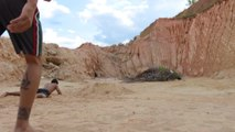 Guy Trying Double Side Flip Parkour Trick Faceplants into Sand