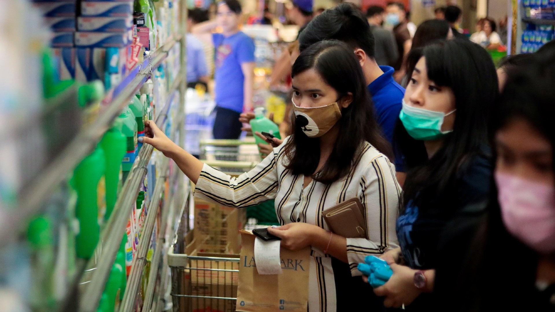 Philippines reports coronavirus death, China toll reaches 304