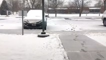Time-lapse video of snow accumulating over this parking lot