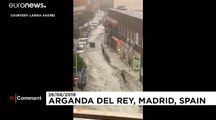 Flash flooding in Madrid region sweeps away vehicles