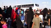 Hundreds of displaced Iraqis transferred from camp