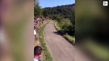 Rally pilot miraculously dodges a spectator who fell in the street