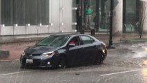 Guy Uses Cup to Drain Water Out of Waterlogged Car
