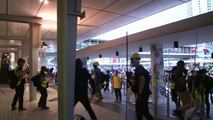 Hong Kong protesters target transit station as riot police mount search